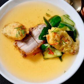 Kimchi consommé with crispy roast pork belly and tempura mussels Featured-More Favorites Inspired by the flavors of Asia Main Course Soup