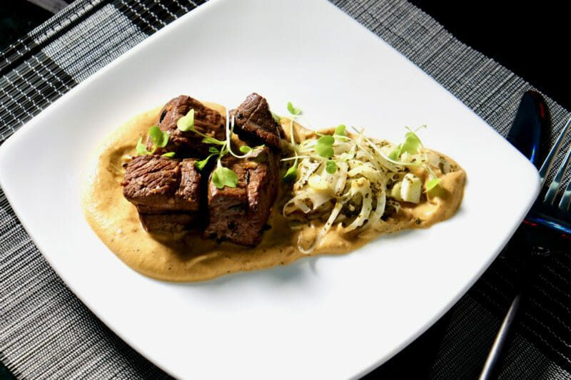Lamb, marinated and grilled, on a roasted eggplant and garlic puree. Inspired by the flavors of the Mediterranean Main Course