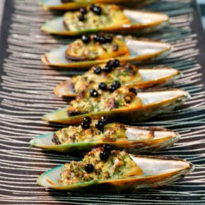 Mussels grilled with roast garlic and butter Appetiser Featured-More Favorites Inspired by the flavors of the Mediterranean Seafood Tapas